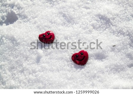 Heart buttons on snow  #1259999026