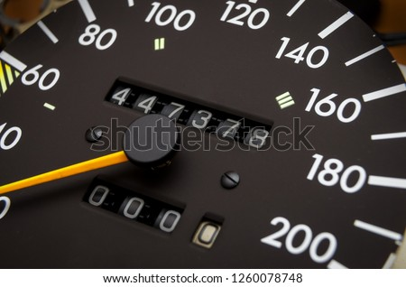Close up shot of a speedometer in a car. Car dashboard. Dashboard details with indication lamps.Car instrument panel. Dashboard with speedometer, tachometer, odometer. Car detailing. Modern interior Royalty-Free Stock Photo #1260078748