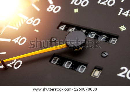 Close up shot of a speedometer in a car. Car dashboard. Dashboard details with indication lamps.Car instrument panel. Dashboard with speedometer, tachometer, odometer. Car detailing. Modern interior Royalty-Free Stock Photo #1260078838