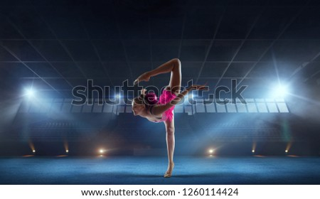 Rhythmic gymnast in professional arena. #1260114424