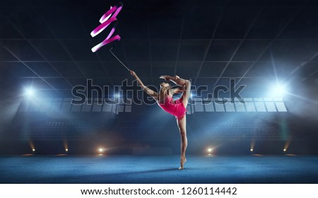 Rhythmic gymnast in professional arena. #1260114442