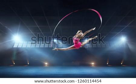 Rhythmic gymnast in professional arena. #1260114454