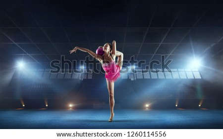 Rhythmic gymnast in professional arena. #1260114556