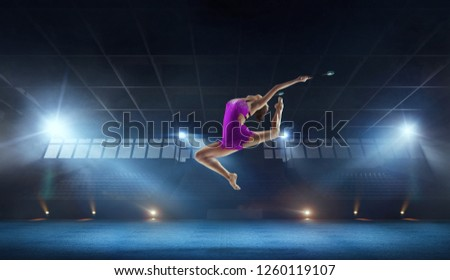 Beautiful rhythmic gymnast in professional arena. #1260119107