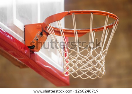 Basketball hoop close up in old school sport gym hall #1260248719