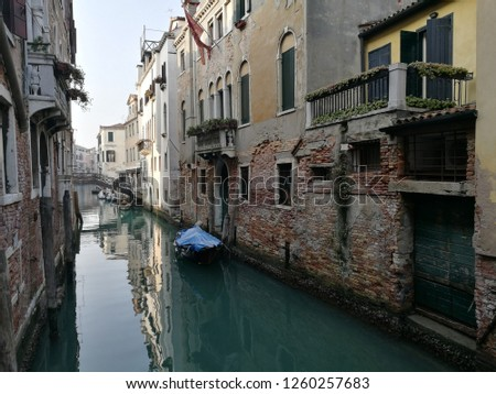 Venice. Beautiful view. Canal, boat and walls of houses. #1260257683