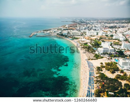 Cyprus beautiful coastline, Mediterranean sea of turquoise color. Houses on the Mediterranean coast. Tourist town with a Long beach. Summer vacation at sea. top view, aerial view. Cyprus, Ayia NAPA. #1260266680