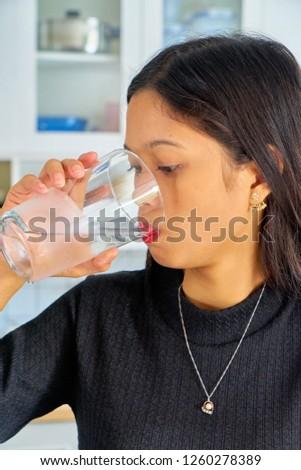 Beautiful woman posing - drinking water, thinking #1260278389