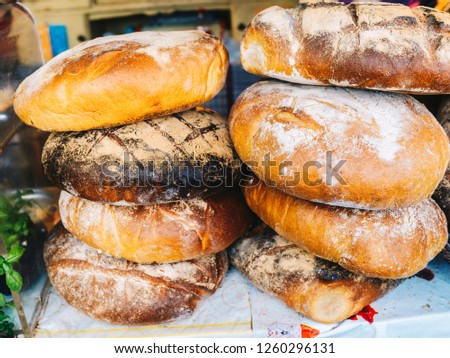 loaves of homemade bread baked in a traditional wood-fired oven #1260296131