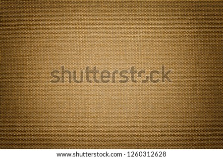 Dark brown background from a textile material with wicker pattern, closeup. Structure of the bronze fabric with texture. Cloth backdrop with vignette. #1260312628