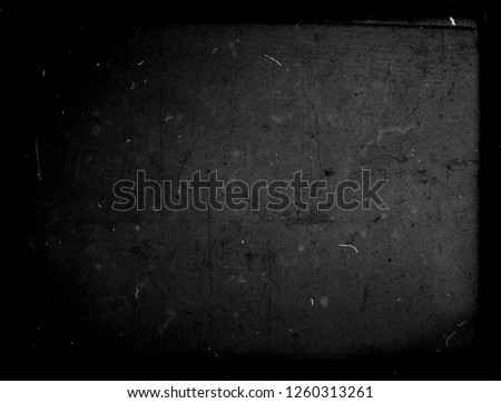 Grunge black scratched background with frame, old film effect, distressed scary texture #1260313261