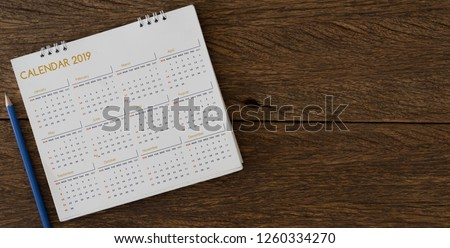 close up soft focus on pencil and calendar 2019 on wood background table office desk with top view concept
