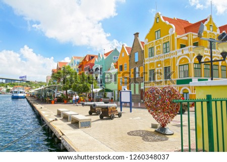 Willemstad, Curacao. Dutch Antilles.  Colourful Buildings attracting tourists from all over the world. Blue sky sunny day. #1260348037
