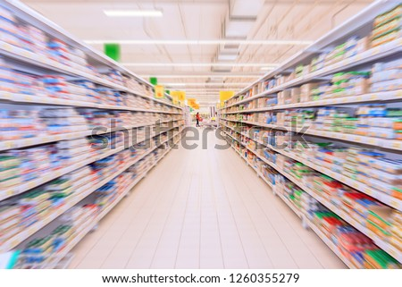 grocery store interior, shelves with boxes and jars in radial blur Royalty-Free Stock Photo #1260355279