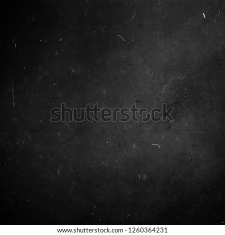Black chalkboard, scratched grunge background, dusty texture, old film effect, copy space #1260364231