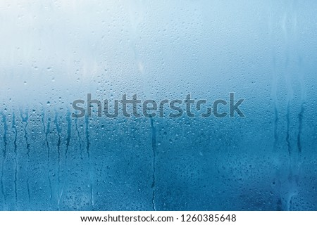 Condensation on the clear glass window. Water drops. Rain. Abstract background texture Royalty-Free Stock Photo #1260385648