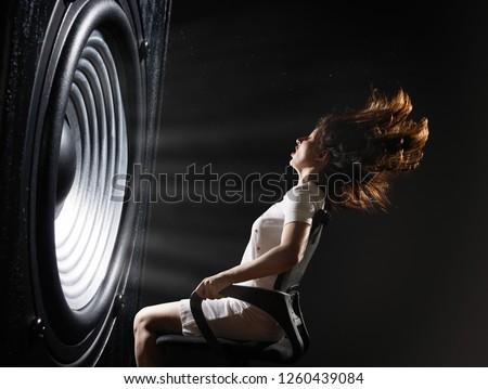 The sound wave set back an office chair with young woman. #1260439084