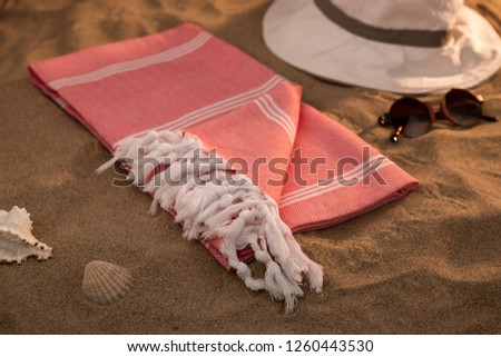 Handwoven hammam Turkish cotton towel on beach #1260443530