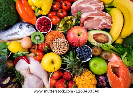 Background healthy food. Fresh fruits, vegetables, meat and fish on table. Healthy food, diet and healthy life concept. Top view  #1260483340