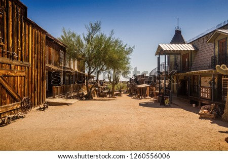 Old Western Goldfield Ghost Town square with huge cactus and saloon, photo taken during the sunny day with clear blue sky Royalty-Free Stock Photo #1260556006