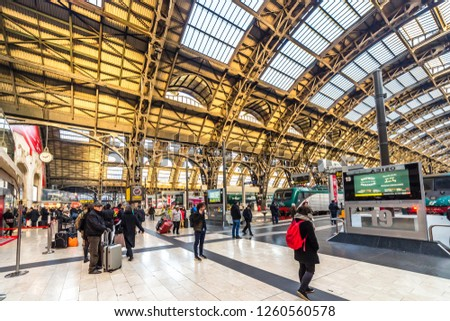MILANO, ITALY - DECEMBER 12, 2018: travelers watching the trains departing at Milano Centrale station #1260560578