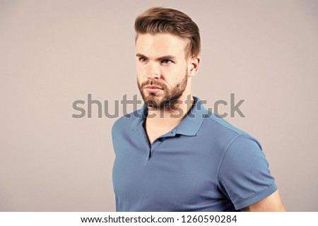 Handsome bearded man in blue tshirt with stylish hair #1260590284