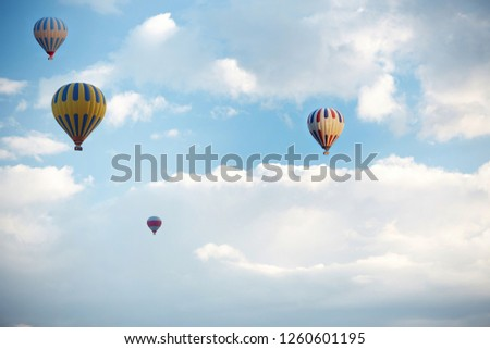 Group of hot air balloons flying in the sky #1260601195