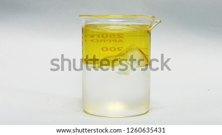 materials with different densities, water, ice, oil and stone Royalty-Free Stock Photo #1260635431