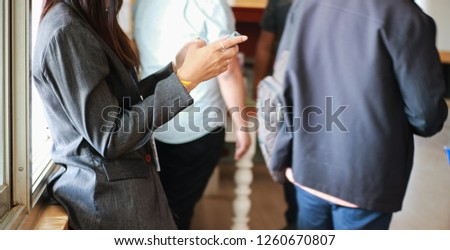 Business women using smartphone #1260670807