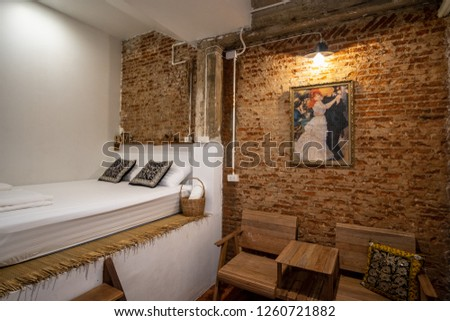 A private bedroom of a hostel  decorated with beautiful brick wall makes traveler feel comfy and cozy