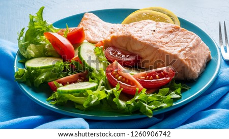 Steam salmon and vegetables, Paleo, keto, fodmap diet. Classic blue plate on blue table, side view, long banner #1260906742