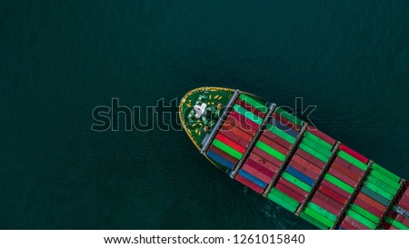 Container ship carrying container for import and export, Aerial view business logistic and freight transportation by ship in open sea. #1261015840