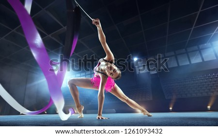 Rhythmic gymnast in professional arena. #1261093432