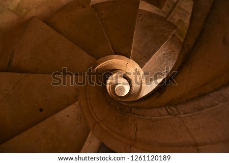 Intriguing, Absorbing Central View Down a Winding Stone Staircase #1261120189