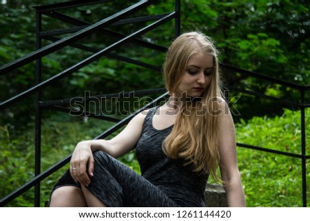 Beautiful girl on the stairs #1261144420