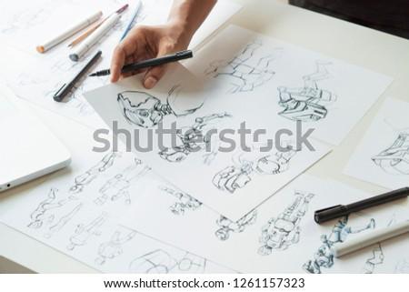 Animator designer Development designing drawing sketching development creating graphic pose characters sci-fi robot Cartoon illustration animation video game film production , animation design studio. #1261157323