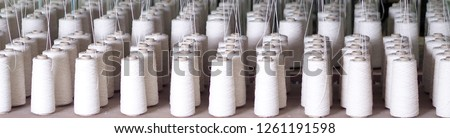 Row of textile threads industry . Royalty-Free Stock Photo #1261191598