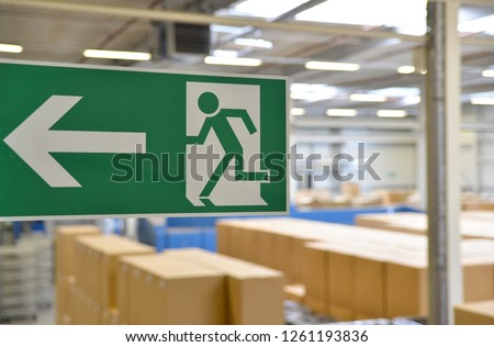 emergency exit sign in the warehouse of an industrial company