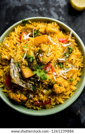 Masala Rice or masale bhat - is a spicy vegetable fried rice / biryani or Pulav usually made during wedding occassions in maharashtra, India #1261239886