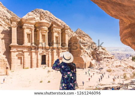 Asian young woman in colorful dress and hat enjoying at The Monastery, Petra's largest monument, UNESCO World Heritage Site, Jordan. #1261246096