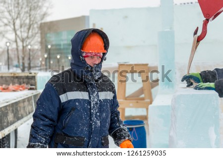 Portrait of a worker engaged in arranging an ice town #1261259035