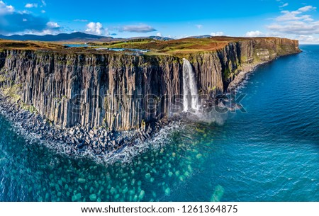 Aerial view of the dramatic coastline at the cliffs by Staffin with the famous Kilt Rock waterfall - Isle of Skye - Scotland. #1261364875