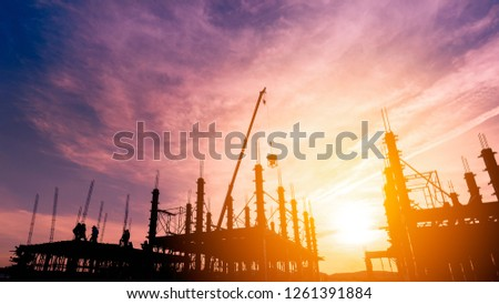 worker pouring concrete on high ground over blurred background sunset pastel #1261391884