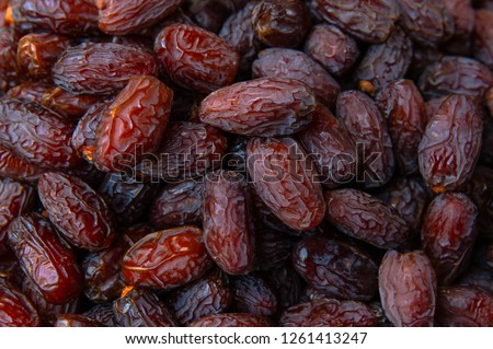 Dried date fruits background Royalty-Free Stock Photo #1261413247