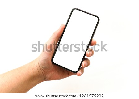 Man's Hand Holding New Model of Smartphone with Blank Screen on White Background #1261575202