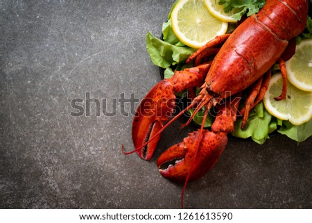 freshly boiled lobster with vegetable and lemon #1261613590
