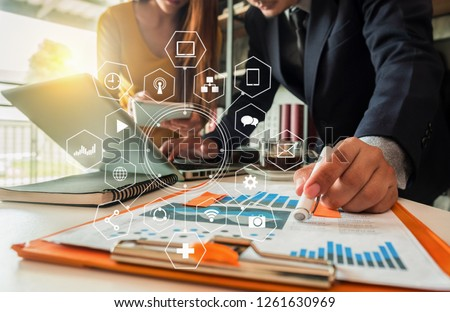 Business team present. professional investor working new start up project. tablet laptop computer with digital marketing media in the office. #1261630969