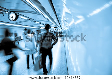 business people walk at subway station abstract blur #126163394