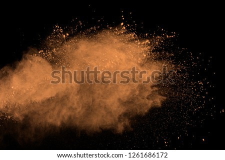 Abstract brown powder splatted background. Colorful powder explosion on black background. Colored cloud. Colorful dust explode. Paint Holi. #1261686172