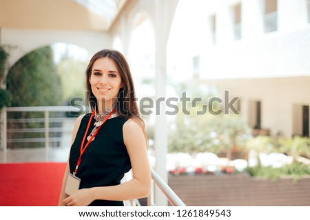 Event Planner Coordinator PR Specialist Employee at Formal Event  Authorized manager wearing a badge welcoming guests at hotel entrance  #1261849543